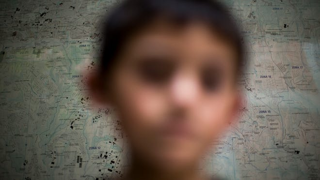 A child, alone, confused, frightened and in charge of his own deportation case.