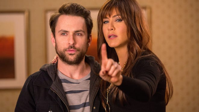 """Charlie Day and Jennifer Aniston appear in a scene from """"Horrible Bosses 2."""""""
