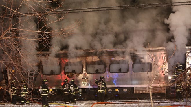 Firefighters work at the scene of a train vs car accident at the Commerce Street crossing in Valhalla Feb. 3, 2015.