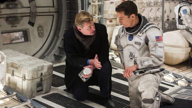Interstellar director Christopher Nolan, left, talks with actor Matthew McConaughey. Nolan used Kodak film for the movie.