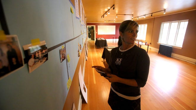 Tiffany Bulgin, co-owner of The IKE Box, works on a timeline of the nonprofits history on Friday Oct. 24, 2014 in Salem, Ore.