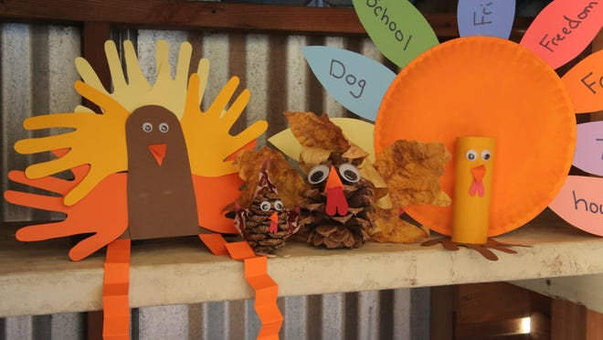 Three simple turkey crafts are made using common items such as paper plates, construction paper, leaves and pine cones.