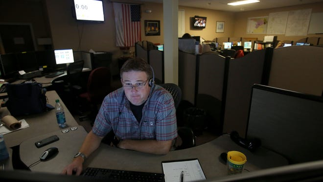 Dispatcher Michael Moran fields calls at the Willamette Valley Communications Center on Wednesday, Nov. 26, 2014, in Salem, Ore.