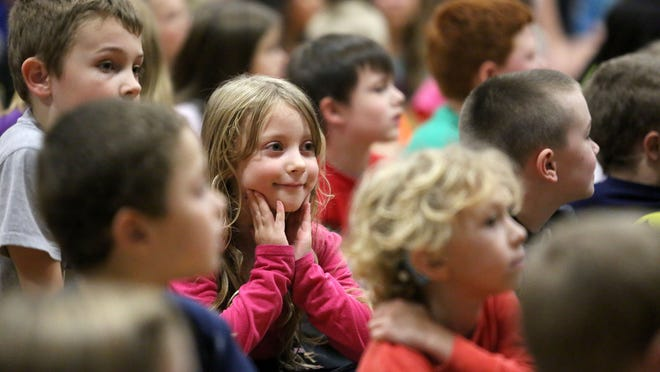 Students at Salem Heights Elementary School attend an assembly on Friday Oct. 31, 2014 in Salem, Ore. Fifth-grader Matthew Gauntt won an SJ Kids award with his explanation for why people get goose bumps.