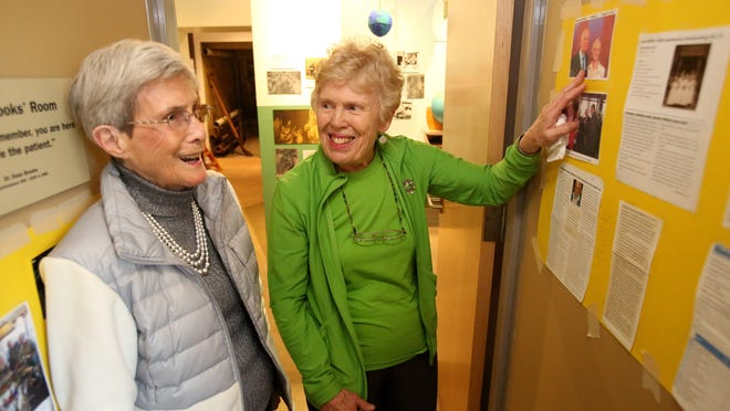 Ruth Tyler, right, shares a laugh with JoAn Hoy, her roommate while they were training to be nurses in the 1950s. They were among seven nurses who gathered Monday, Feb. 9, at the Museum of Mental Health to reminisce about their three-month rotation at the Oregon State Hospital.