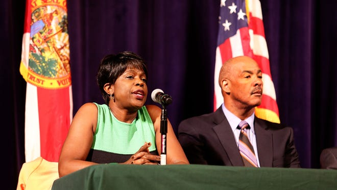 FAMU president Elmira Mangum and Kellen Winslow at a recent town hall meeting on suspension of golf and men's tennis teams.