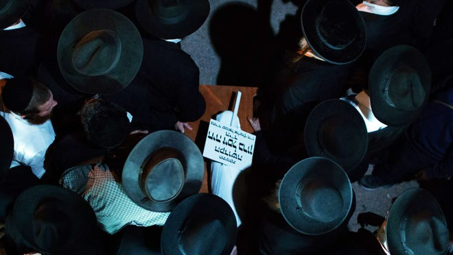 """Ultra-orthodox Jewish mourners carry the body of three-month-old baby Chaya Zissel Braun during her funeral in Jerusalem on October 23, 2014 after she was killed in what Israeli police called a """"hit-and-run terror attack"""" when a Palestinian driver rammed a group of pedestrians.  Nine others were injured in the attack.  Abed Abdelrahman Shaludeh, 21, was shot and wounded by police as he tried to flee the scene. He later died of his injuries.  AFP PHOTO/MENAHEM KAHANAMENAHEM KAHANA/AFP/Getty Images"""