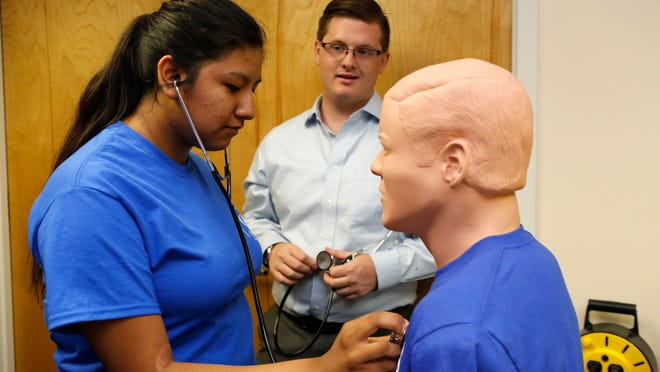 Open Door Family Medical Centers plans to open a no-cost clinic at Ossining High School, where student Ana Priego, 16, pictured, learned to identify heart sounds on a mannequin in July with Open Door.