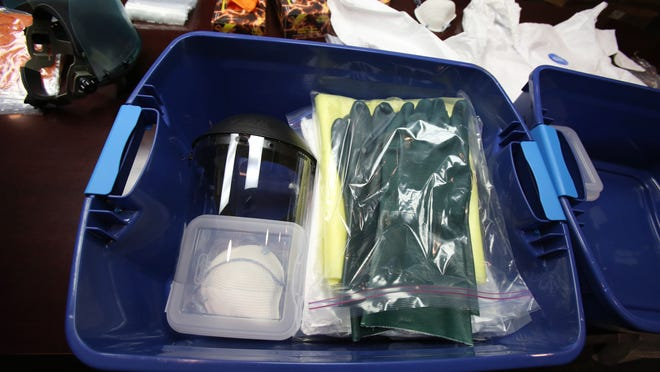 Paramedics put together kits of personal protection equipment at Rockland Paramedics in Chestnut Ridge. The kits would be used while treating an Ebola patient.