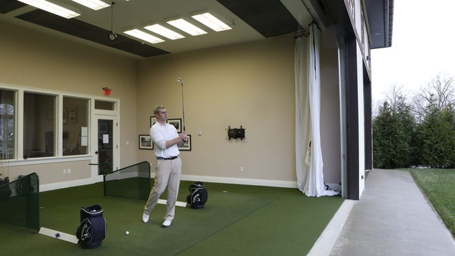 Bryan Gubser, an assistant pro at Westchester Country Club, practices in the club's indoor hitting facility.