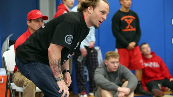 North Rockland assistant wrestling coach John Hoke encourages wrestler Tim Henion during the O'Connell Wrestling Tournament at Pearl River High School Dec. 29, 2014.