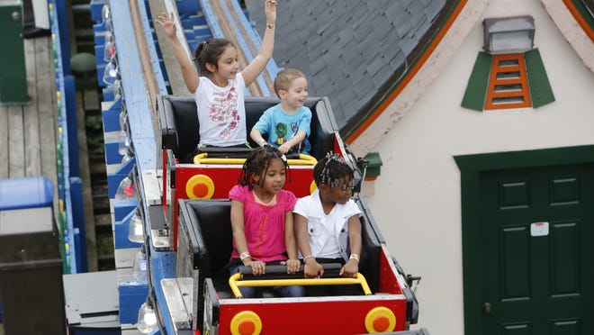 Children ride the Kiddie Coaster at Playland on opening day 2014. It is unlikely Westchester County government will hand over day-to-day management of the park by opening day this year.