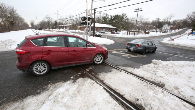 Cars waiting to cross Western Highway sometimes back up beyond the CSX railroad tracks.