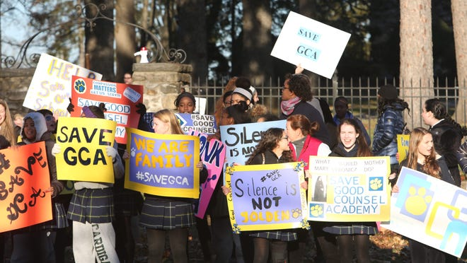 Students from Good Counsel Academy rallied outside the school on North Broadway in White Plains in November in an effort to keep their school open.