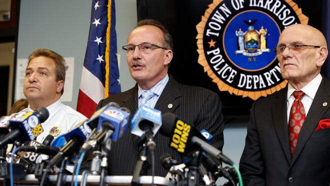 Harrison Police Chief Anthony Marraccini, center, and town Supervisor Ron Belmont  at a February 2015 news conference
