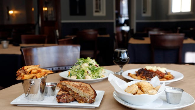 The short rib grilled cheese, fried pickles, craft salad and poutine are photographed at the Craft House in Suffern. The gastropub serves classic American dishes and focuses on local, seasonal, hand-crafted food as well as craft beers, wine and spirits.