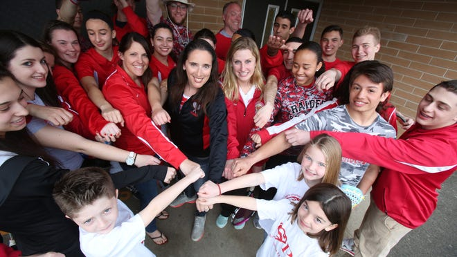 North Rockland High School athletes and tennis coach Jen LaBier, center, in black, get ready April 3, 2015 at the school for North Rockland Sports Day for Charity. The fund raising event will be held on Apr. 11. In front are LaBier's third grade students from Stony Point Elementary, Donny Grom, left, Meagan McGovern and Patrice Alessi. The three came up with the idea for Sports Day.