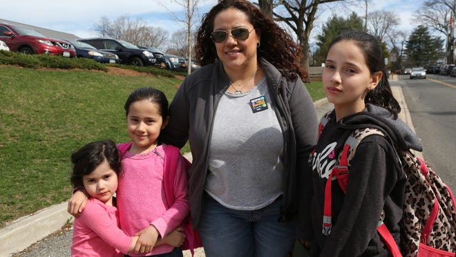 Sofia DePietro, right, a fifth grader at the Post Road School in White Plains, with her mother, Juliana, and sisters Sydney and Valentina on Wednesday. Sofia opted out of the state test.