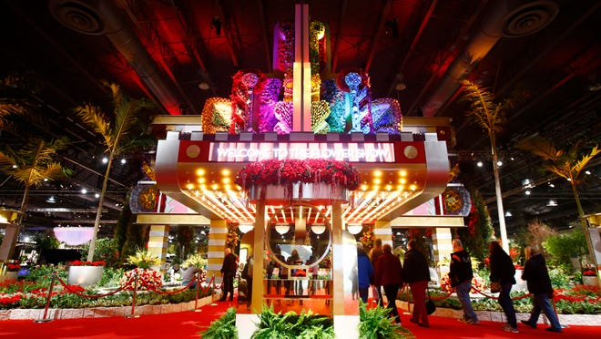 """The glittering entrance plaza sets the tone for the """"Celebrate the Movies"""" themed Philadelphia Flower Show."""