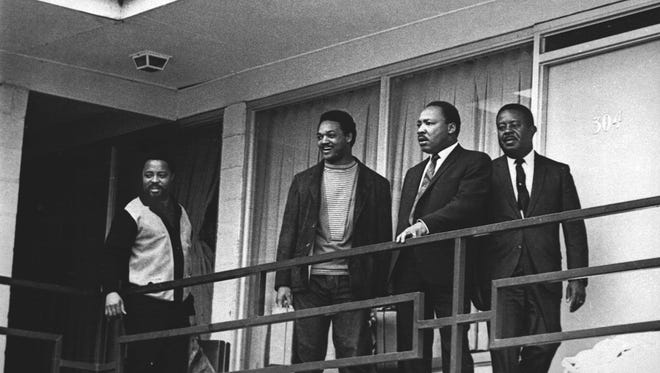 In this April 3, 1968 file photo, the Rev. Martin Luther King Jr. stands with other civil rights leaders on the balcony of the Lorraine Motel in Memphis, Tenn., a day before he was assassinated at approximately the same place. From left are Hosea Williams, Jesse Jackson, King, and Ralph Abernathy. King is one of America's most famous victims of gun violence. Just as guns were a complicated issue for King in his lifetime, they loom large over the 30th anniversary of the holiday honoring his birthday.