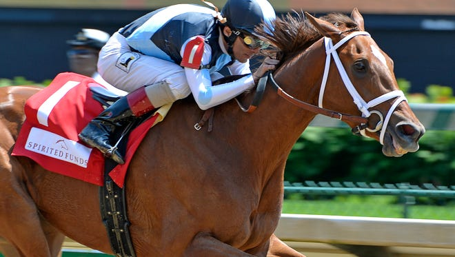 Curalina, with jockey John Velazquez up, crosses the finish line to win the 31st running of The La Troienne, Friday, May. 06, 2016 in Louisville Ky. (Timothy D. Easley/Special to the C-J)