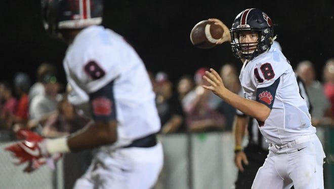 Belton-Honea PathÊquarterback Camden Bratcher throws to  Zy Scott for a first down against Palmetto during the third quarter at Palmetto High School in Williamston on Friday.