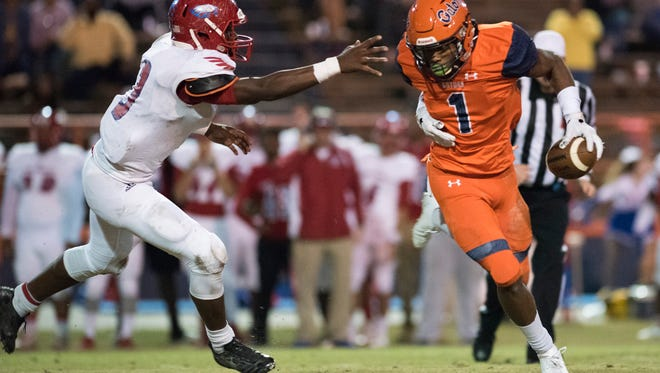 Escambia High School's Jacob Copeland, (No. 1) runs past Pine Forest High School's Jaylen Clausell, (No.3)  during Friday night's District 1-6A football playoffs.