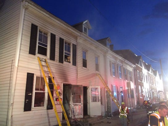 A fire displaced three adults and one child from a