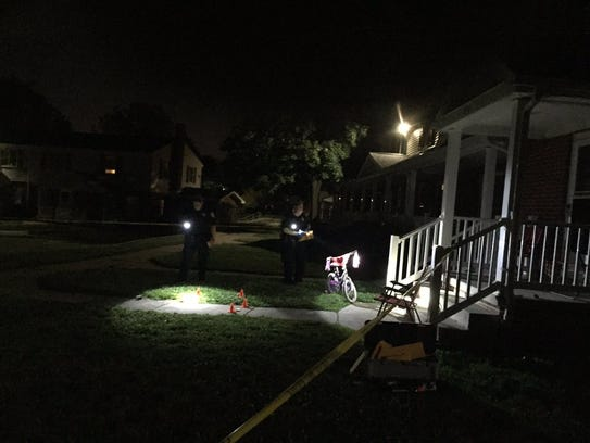 Police investigate outside a home on the 600 block