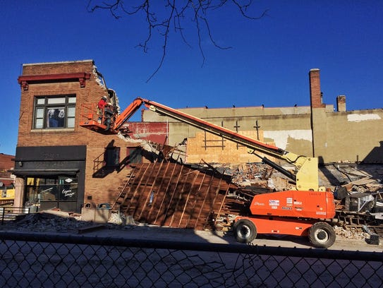 Crews begin to demolish the old Copper Lounge building