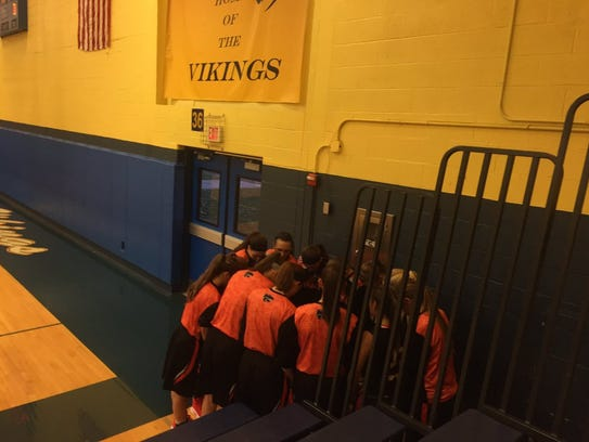 The Palmyra girls basketball team huddles up before