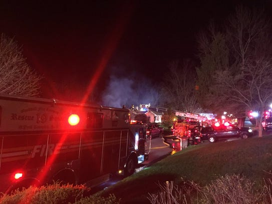 Fire equipment is lined up near a blaze in York Township