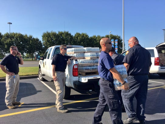 Nashville first responders leave from a Nissan Stadium