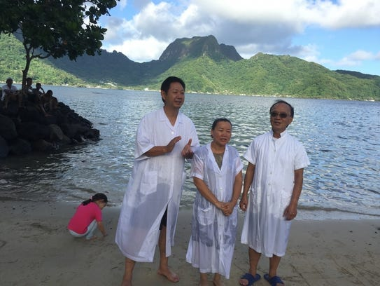 Pastor Dawson Zhang, of Hattiesburg Christian Chinese Church, left, is pictured with a woman from Mainland China, whom he baptized in American Samoa in 2015 while on a mission trip.