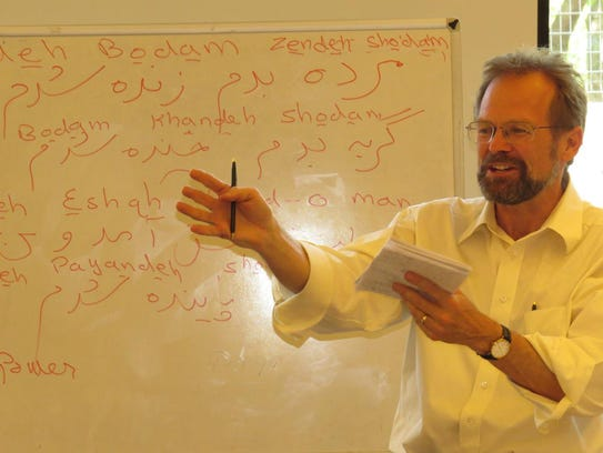 Christopher Merrill is shown discussing translation in Konya, Turkey in 2013. Photo from the International Writing Program.