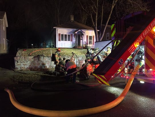Crews out in front of the home on Covell Avenue.