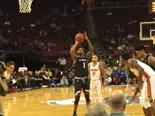 Jacob Evans hits a free throw for the University of