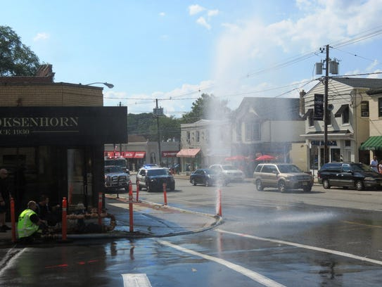 In Millburn, a geyser of water shoots into the air
