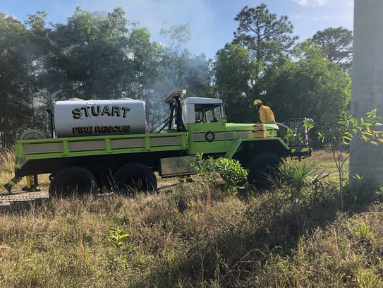 Stuart Police Department reported a brush fire behind