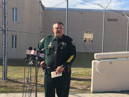 Sheriff Wayne Ivey gives a press conference outside