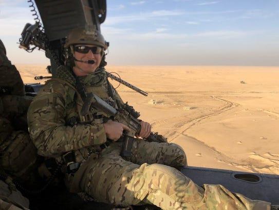 Air Force Reserve Pararescuemen Staff Sgt. Carl Enis,