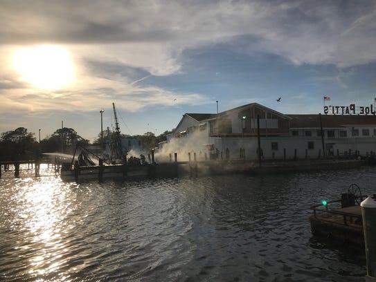 Crews work to extinguish boat fire at Joe Patti seafood
