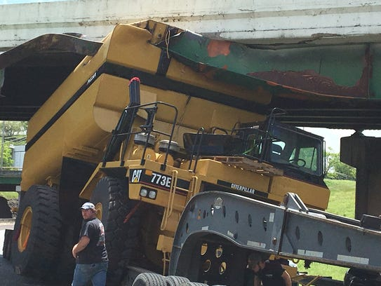 A truck carrying an oversized load hit the 40E overpass