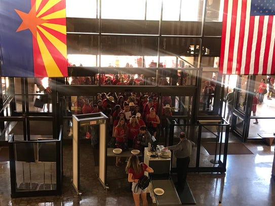 Dozens of teachers enter the Arizona state Capitol