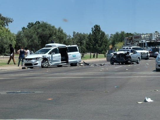 A Honda sedan swerving to avoid another car crashed