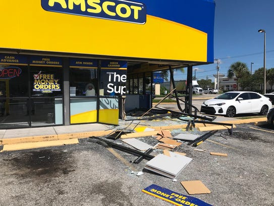 No one was hurt when a car crashed into an Amscot store