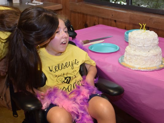 "ANI Kelsey's party Jessica Desselle kisses daughter Kelsey Deselle after everyone sang ""Happy Birthday"" to Kelsey at her birthday party. Kelsey has Nonketotic Hyperglycemia and STEPScenla hosted a meet and greet with Kelsey at the zoo where she celebrated"