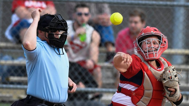 University of Southern Indiana catcher Haley Hodges throws toward first base in a home game with Bellarmine Tuesday, March 4, 2017.