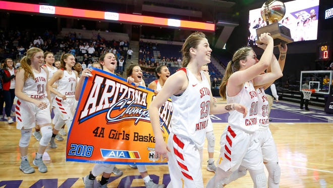 Seton Catholic Prep celebrates defeating Pueblo in the 4A Girls state championship basketball game in Phoenix on February 24, 2018.