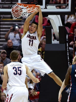 Arizona forward Aaron Gordon dunks a basket against Gonzaga during the first half of a third-round game in the NCAA college basketball tournament in San Diego. Gordon is a possible pick in the 2014 NBA Draft, Thursday, June 26, 2014 in New York.